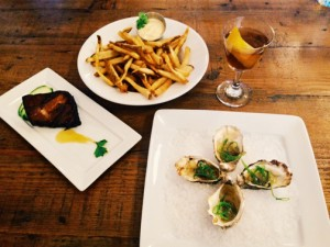 Pork belly, oysters, fries and a refreshing beverage. Way to be!  PHOTO BY RYAN RUSSELL