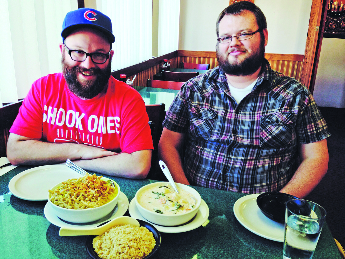 Aaron Apple (left) ordered the Kao Soi , and Aaron Kayser tried the Musumun curry with chicken. PHOTO BY RYAN RUSSELL