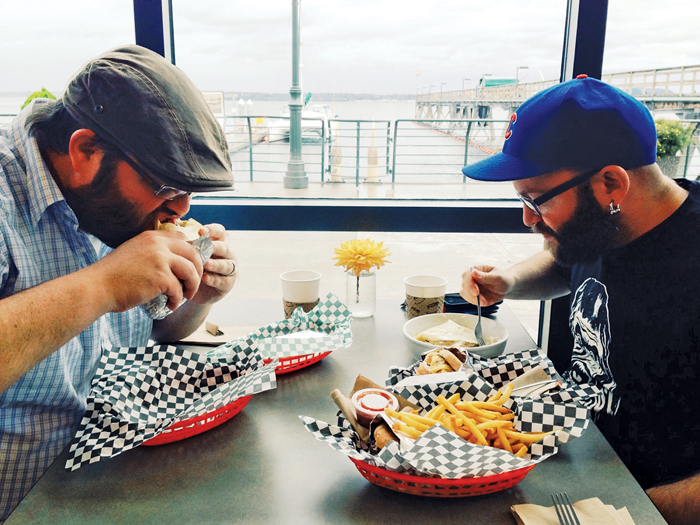The Aarons gobble up a Shrimp Po Boy, Migas breakfast taco, biscuits and gravy, and Honeybear breakfast sandwich. PHOTO BY RYAN RUSSELL
