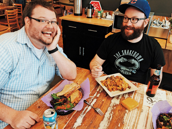 Aaron Kayser (left) enjoyed the Reuben and Aaron Apple (right) went with the pulled pork hash. PHOTO  BY RYAN RUSSELL
