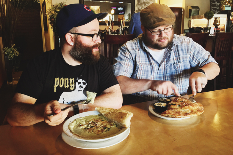The Aarons enjoy the spinach ravioli with creamy pesto and creamy chicken artichoke calzone. PHOTO BY RYAN RUSSELL