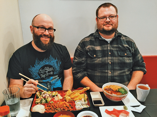 The Aarons enjoy a bento box (chicken with Korean garlic sauce),  chicken udon, tuna nigiri, and green tea. Photo by Ryan Russell