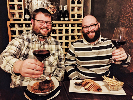 The Aarons enjoy their final Stuff Yer Face together, toasting at the new EAT Restaurant. It's the end of an era, we'll miss you Apple! PHOTO BY RYAN RUSSELL
